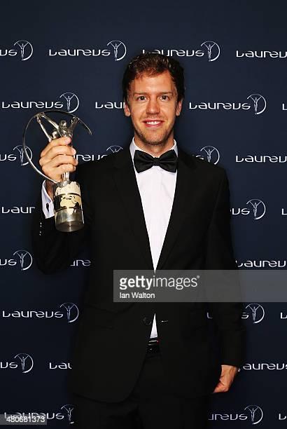 Sebastian Vettel winner of the Laureus World Sportsman of the Year award poses with their trophy during the 2014 Laureus World Sports Awards at the...