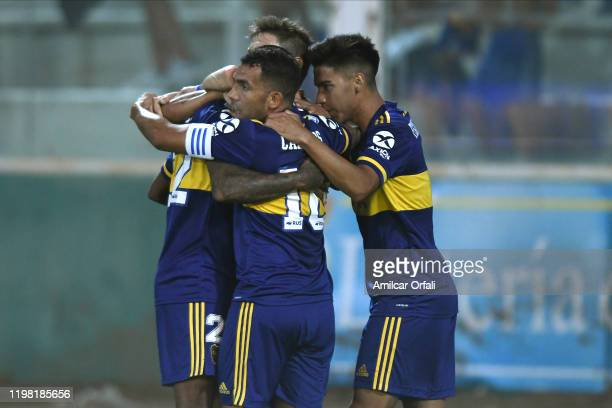 Sebastian Villa of Boca Juniors celebrates with teammates Carlos Tévez and Guillermo Fernández after scoring the first goal of his team during a...