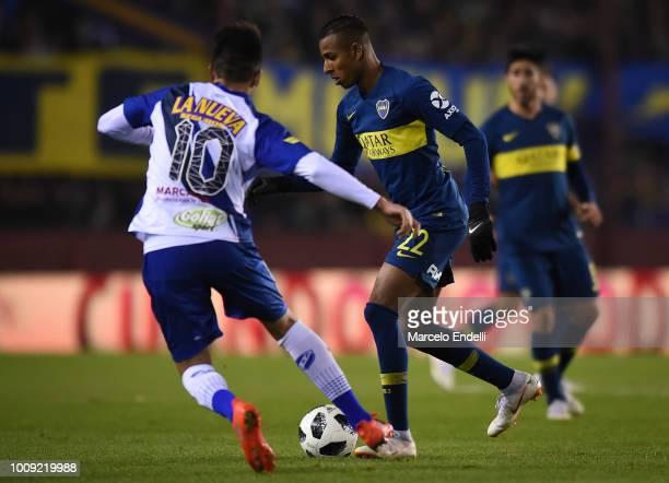 Sebastian Villa of Boca Juniors fights for the ball with Cristian Canuhe of Alvarado during a match between Boca Juniors and Alvarado as part of...
