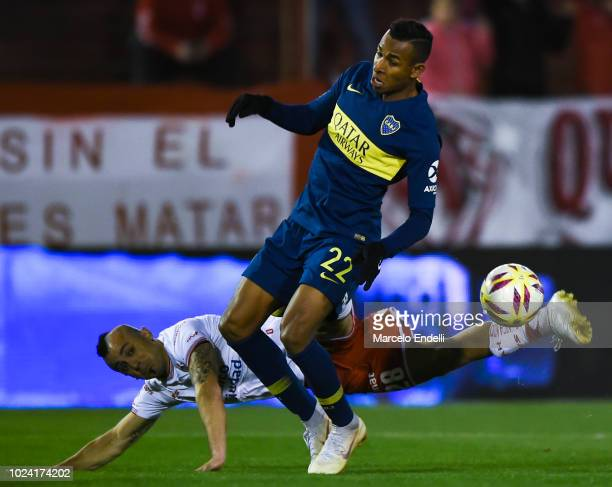 Sebastian Villa of Boca Juniors fights for the ball with Cristian Chimino of Huracan during a match between Huracan and Boca Juniors as part of...