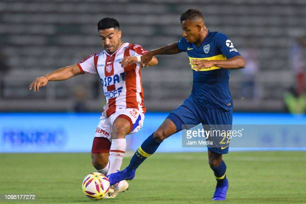 Sebastian Villa of Boca Juniors fights for the ball with Nelson Acevedo of Union during a friendly match between Boca Juniors and UniÛn de Santa Fe...
