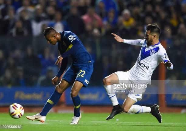 Sebastian Villa of Boca Juniors kicks the ball to score the third goal of his team during a match between Boca Juniors and Velez as part of Superliga...