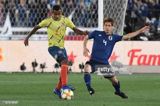 Sebastian Villa of Colombia and Sho Sasaki of Japan compete for the ball during the international friendly match between Japan and Colombia at Nissan...