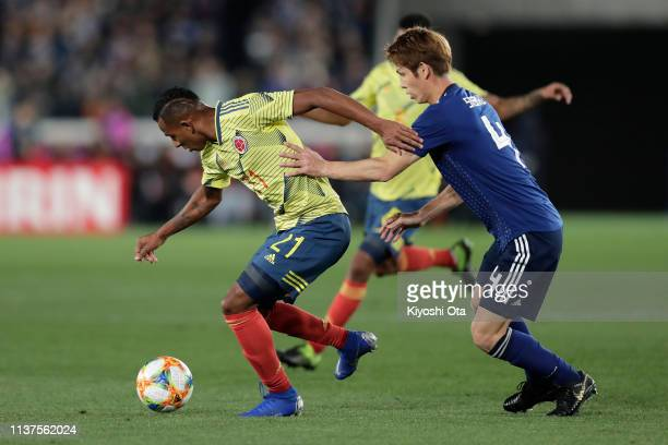 Sebastian Villa of Colombia and Sho Sasaki of Japan in action during the international friendly match between Japan and Colombia at Nissan Stadium on...