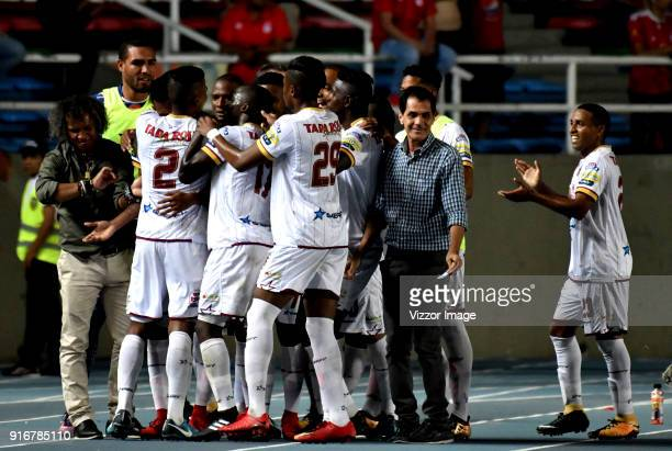 Sebastian Villa of Deportes Tolima celebrates with teammates after scoring the first goal of his team during a match between America de Cali and...
