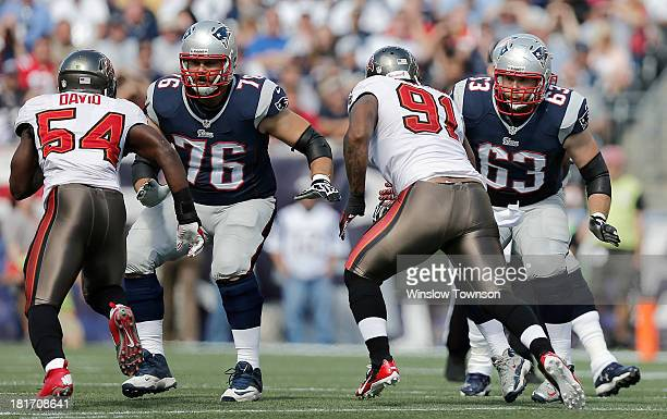 Sebastian Vollmer of the New England Patriots and Dan Connolly of the New England Patriots pass block against the Tampa Bay Buccaneers during the...
