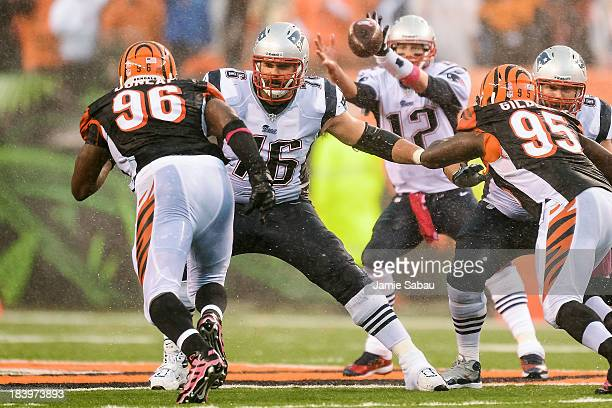 Sebastian Vollmer of the New England Patriots blocks against Carlos Dunlap of the Cincinnati Bengals at Paul Brown Stadium on October 6 2013 in...