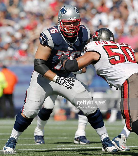 Sebastian Vollmer of the New England Patriots prepares to block Daniel Te'oNesheim of the Tampa Bay Buccaneers during the second half at Gillette...