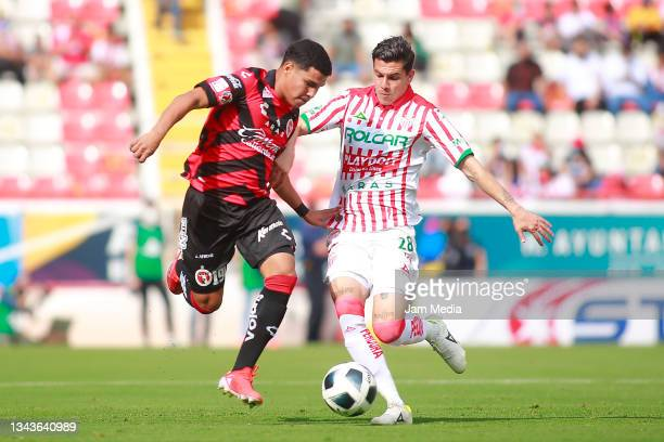 Sebastian Yañez of Tijuana fights for the ball with Luis Arcadio Garcia of Necaxa during the 11th round match between Necaxa and Club Tijuana as part...