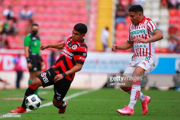 Sebastian Yañez of Tijuana fights for the ball with Maximiliano Salas of Necaxa during the 11th round match between Necaxa and Club Tijuana as part...