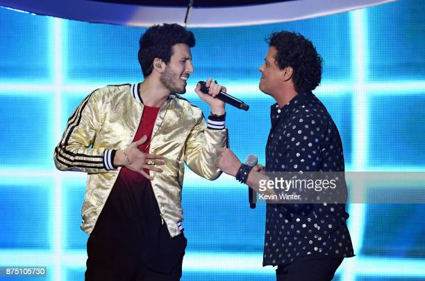 Sebastian Yatra and Carlos Vives perform onstage at the 18th Annual Latin Grammy Awards at MGM Grand Garden Arena on November 16 2017 in Las Vegas...