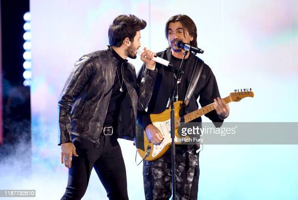 Sebastian Yatra and Juanes perform onstage during the 20th annual Latin GRAMMY Awards at MGM Grand Garden Arena on November 14 2019 in Las Vegas...