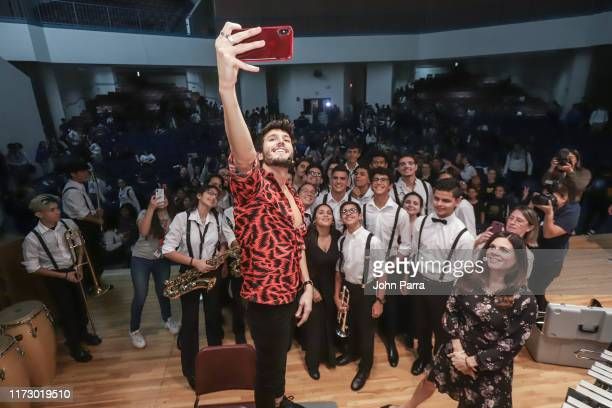 Sebastian Yatra and the music students during the Latin GRAMMY in the Schools Miami 2019 on October 1, 2019 in Miami, Florida.