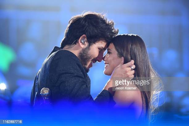 Sebastian Yatra and Tini perform on stage during Premios Juventud 2019 at Watsco Center on July 18 2019 in Coral Gables Florida