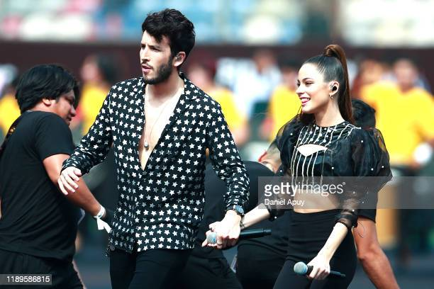 Sebastian Yatra and Tini Stoessel perform during pre-game show prior to the final match of Copa CONMEBOL Libertadores 2019 between Flamengo and River...