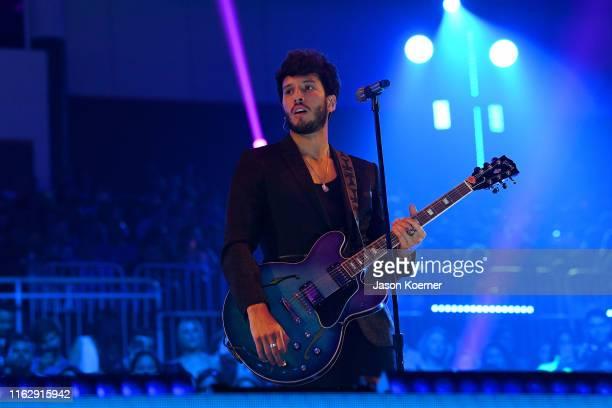 Sebastian Yatra performs on stage during Premios Juventud 2019 at Watsco Center on July 18, 2019 in Coral Gables, Florida.