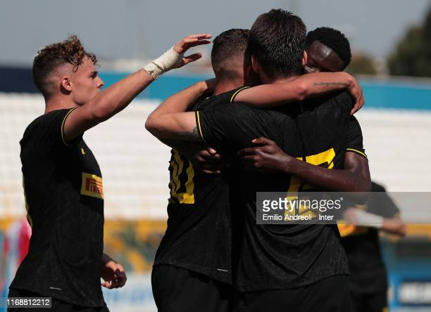 Sebastiano Esposito of FC Internazionale celebrates with his teammates after scoring the opening goal during the UEFA Youth League match between FC...