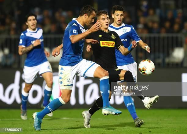 Sebastiano Esposito of FC Internazionale competes for the ball with Ales Mateju of Brescia Calcio during the Serie A match between Brescia Calcio and...
