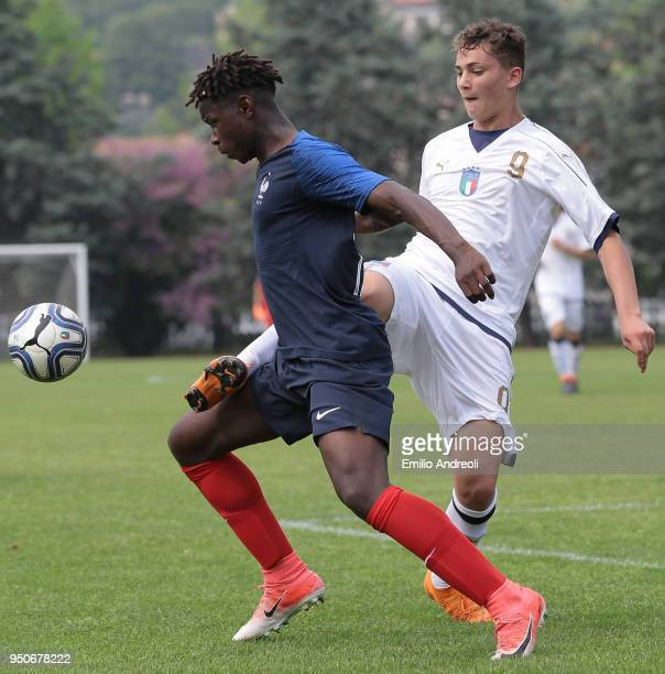 Sebastiano Esposito of Italy competes for the ball with Dann Banzuzi of France during the U16 International Friendly match between Italy and France...