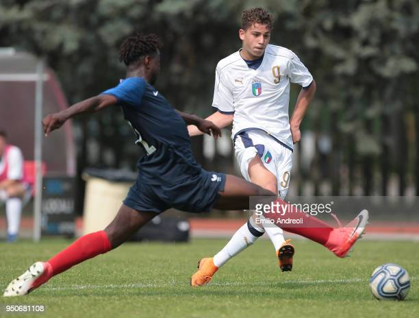 Sebastiano Esposito of Italy is challenged by Dann Banzuzi of France during the U16 International Friendly match between Italy and France on April 24...