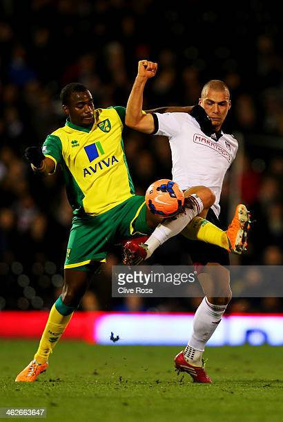 Sebastien Bassong of Norwich City battles with Pajtim Kasami of Fulham during the FA Cup with Budweiser Third round replay match between Fulham and...