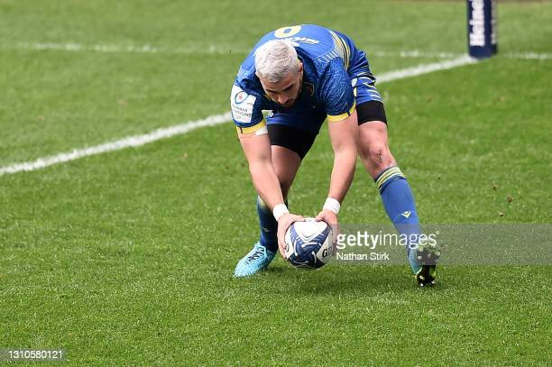 Sebastien Bezy of ASM Clermont Auvergne touches down for his team's first try during the Heineken Champions Cup Round of 16 match between Wasps and...