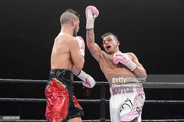 Sebastien Bouchard misses with an uppercut against Denis Farias during the super welterweight bout at Pepsi Coliseum on April 4 2015 in Quebec City...