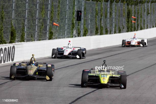 Sebastien Bourdais and Marcus Ericsson race side by side into turn 2 during the ABC Supply 500 on August 18 at Pocono Raceway in Long Pond PA