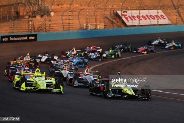 Sebastien Bourdais driver of the Dale Coyne Racing with VasserSullivan Honda IndyCar leads at the start of the Verizon IndyCar Series Phoenix Grand...