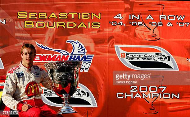 Sebastien Bourdais driver of the McDonald's Newman Haas Lanigan Racing Panoz DP01 poses with the Vanderbilt Cup after winning his fourth consecutive...