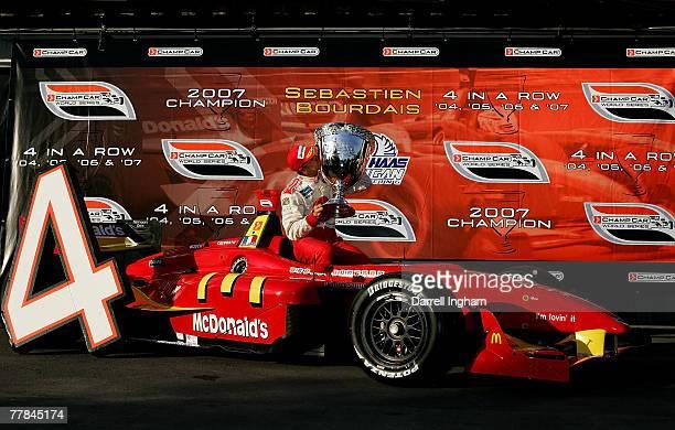 Sebastien Bourdais driver of the McDonald's Newman Haas Lanigan Racing Panoz DP01kisses the Vanderbilt Cup after winning his fourth consecutive title...