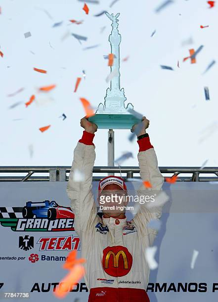 Sebastien Bourdais driver of the McDonald's Newman Haas Lanigan Racing Panoz DP0 celebrates winning the ChampCar World Series Grand Premio Tecate on...