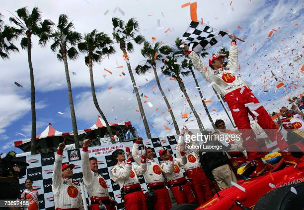 Sebastien Bourdais driver of the Newman Haas Lanigan Racing Panoz DP01 celebrates in victory circle after winning the ChampCar World Series Toyota...