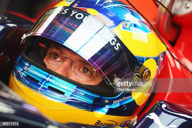 Sebastien Bourdais of France and Scuderia Toro Rosso is seen in his team garage during practice for the Bahrain Formula One Grand Prix at the Bahrain...