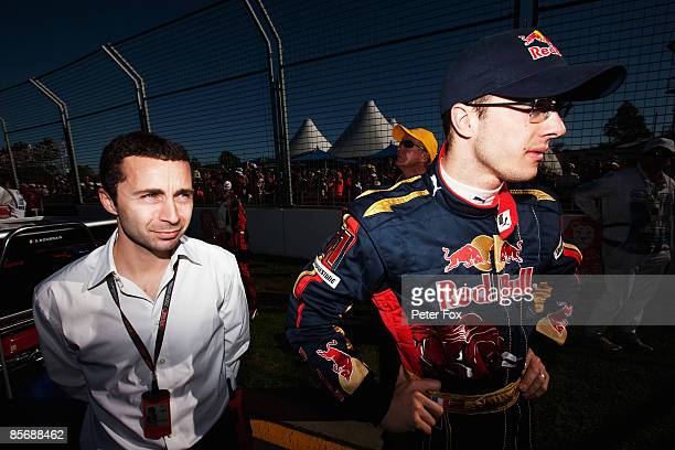 Sebastien Bourdais of France and Scuderia Toro Rosso is seen on the grid with his manager Nicolas Todt before the Australian Formula One Grand Prix...