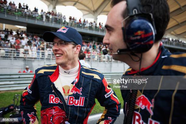 Sebastien Bourdais of France and Scuderia Toro Rosso is seen on the grid before the Malaysian Formula One Grand Prix at the Sepang Circuit on April 5...