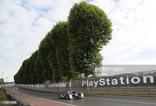 Sebastien Bourdais of France drives the Team Peugeot Total Peugeot 908 during the 79th running of the Le Mans 24 Hour race at the Circuit des 24...