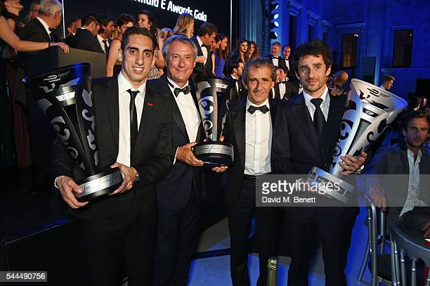 Sebastien Buemi JeanPaul Driot Alain Prost and Nicolas Prost pose with their awards at the 2016 FIA Formula E Visa London ePrix gala dinner at The...