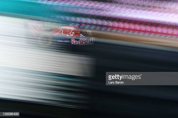 Sebastien Buemi of Switzerland and Scuderia Toro Rosso drives during qualifying for the Hungarian Formula One Grand Prix at the Hungaroring on July...
