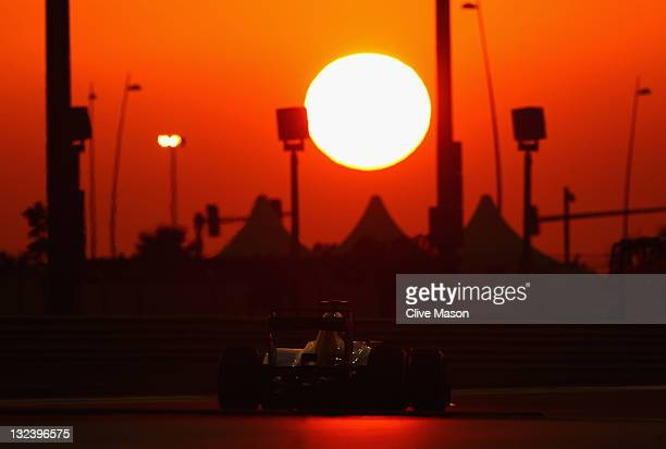 Sebastien Buemi of Switzerland and Scuderia Toro Rosso drives during qualifying for the Abu Dhabi Formula One Grand Prix at the Yas Marina Circuit on...