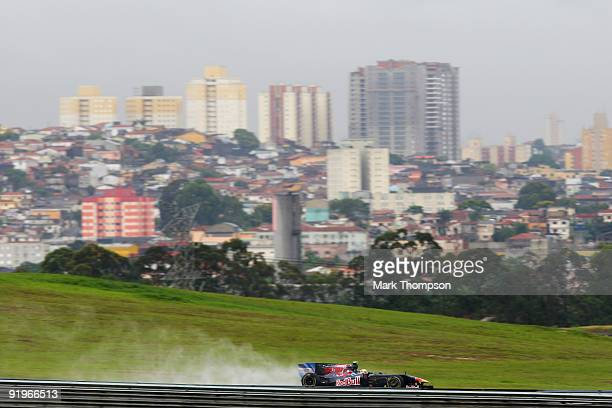 Sebastien Buemi of Switzerland and Scuderia Toro Rosso drives in the rain affected final practice session prior to qualifying for the Brazilian...