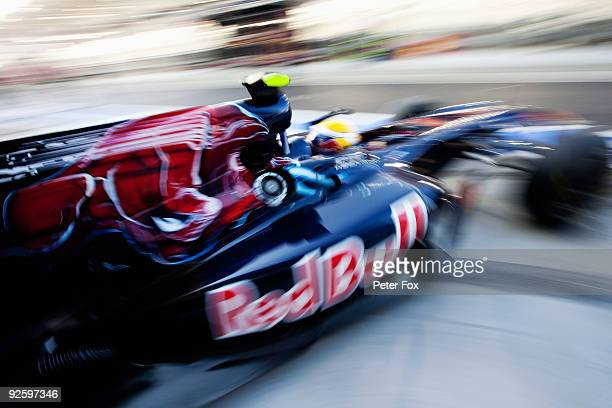 Sebastien Buemi of Switzerland and Scuderia Toro Rosso exits his garage as he prepares to drive during the Abu Dhabi Formula One Grand Prix at the...