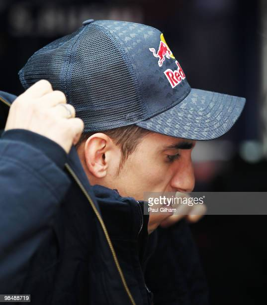 Sebastien Buemi of Switzerland and Scuderia Toro Rosso reacts in his team garage after an accident in which both his front wheels detached from his...