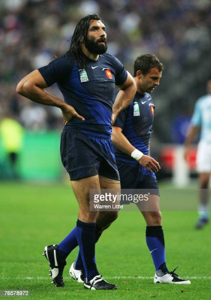 Sebastien Chabal of France walks off with Jean-Baptiste Elissalde of France during the opening match of the Rugby World Cup 2007 between France and...