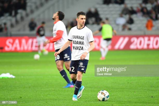 Sebastien Corchia of Lille warms up in a tshirt supporting injured team mates Hamza Mendyl and Adama Soumaoro before the French Ligue 1 match between...