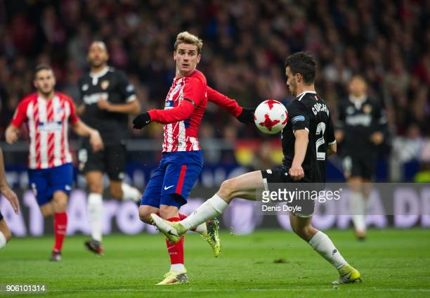 Sebastien Corchia of Sevilla controls the ball beside Antoine Greizmann of Atletico de Madrid during the Copa del Rey Quarter Final First Leg match...