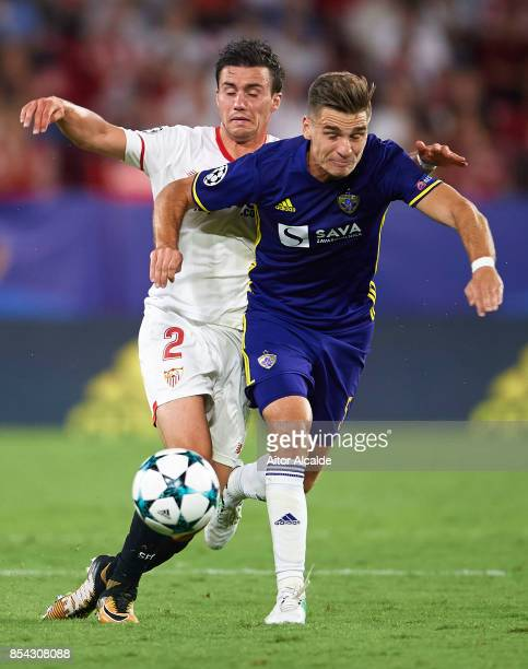 Sebastien Corchia of Sevilla FC competes for the ball with Blaz Vrhovec of NK Maribor during the UEFA Champions League match between Sevilla FC and...