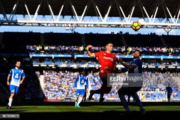 Sebastien Corchia of Sevilla FC competes for the ball with Didac Vila of RCD Espanyol during the La Liga match between Espanyol and Sevilla at Nuevo...