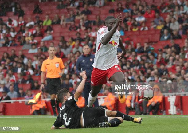 Sebastien Corchia of Seville fouls Daymot Upamecano of RB Leipzig during the Emirates Cup match between RB Leipzig and Sevilla at The Emirates...