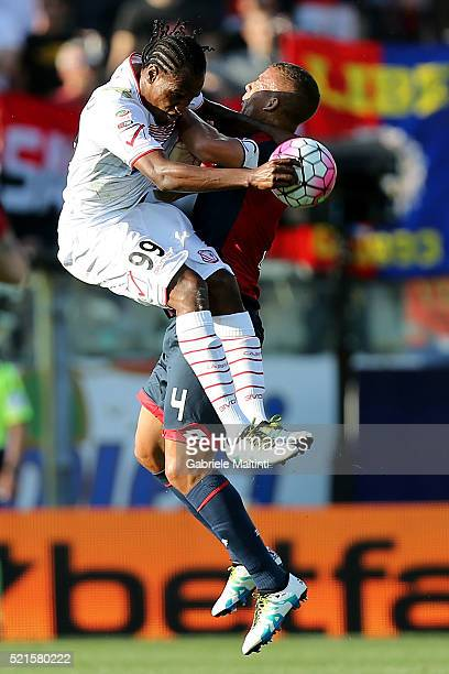Sebastien De Maio of Carpi FC battles for the ball with Jerry Mbakogu of Genoa CFC during the Serie A match between Carpi FC and Genoa CFC at Alberto...